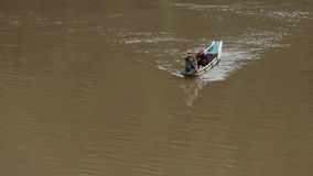 Two men cross the river by boat stock video footage
