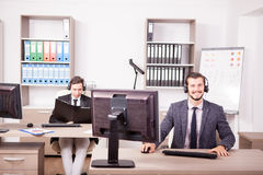 Two men from Customer service support working in the office Stock Photo