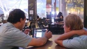 Two men customers scrolling tablet menu in restaurant. 3840x2160. 4k stock footage