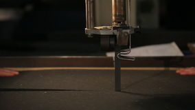 Two men cut polyurethane foam stock video footage