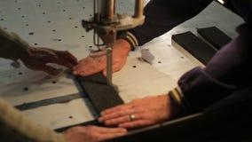 Two men cut polyurethane foam. Production of components made of foam materials (polyurethane foam, polyethylene foam, Eva) and porous rubbers stock video