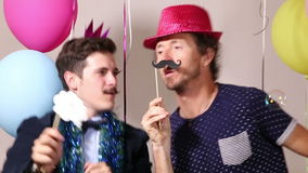 Two men dancing in photo booth stock video