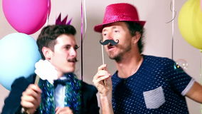 Two men dancing in photo booth stock footage