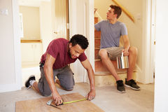 Two men decorating the hallway of a house Stock Photo