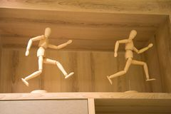 Two men decoration in shelf. Wooden puppet Decorative wood in shelf royalty free stock images