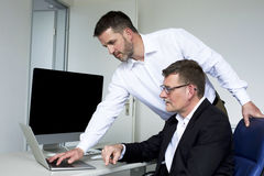 Two men at desk Stock Photos