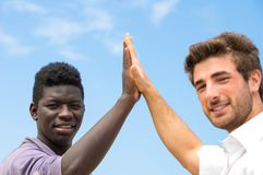 Two men with different skin color Stock Images