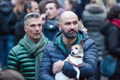 Two men and a dog. Stock Images