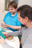 Two men doing a crochet course Stock Photo