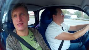 Two men doing test drive of used car stock video