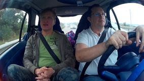 Two men doing test drive of used car stock footage