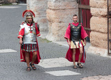 Two men dressed as Roman legionaries near Arena in Verona. Verona, Italy, September 27, 2015 : Two men dressed in the form of Roman legionaries walk around the Stock Images