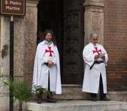 Two men dressed as Templar stand at entrance to church stock photos