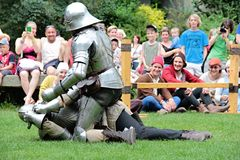 Medieval soldiers in armor fighting. Two men dressed like medieval soldiers in armor. Fighting at a medieval event in the Czech Republic Royalty Free Stock Images