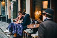 Two men drink a coffee in the outdoor cafe, Stockholm stock image