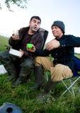 Two men drink vodka Royalty Free Stock Photos
