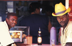 Two men drinking beer in Brazil. Royalty Free Stock Photo
