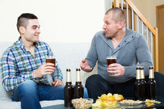 Two men drinking beer Stock Photography
