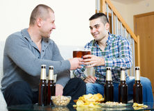 Two men drinking beer Stock Images