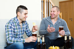 Two men drinking beer Royalty Free Stock Image