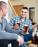 Two men drinking beer Royalty Free Stock Photography