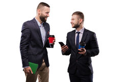 Two men drinking coffee and talking royalty free stock images