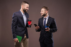 Two men drinking coffee and talking stock photos