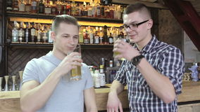 Two men drinks at the bar stock footage