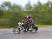 Two men drive on moto Royalty Free Stock Photos