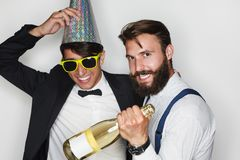 Trendy men partying Royalty Free Stock Photography