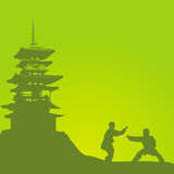 Two men are engaged in a kung fu. Two men are engaged in a kung fu against the monastery stock illustration