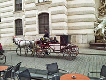 Two men enjoy a trip on Vienna�s fiacre Royalty Free Stock Images