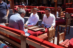 Two men enjoying a game of backgammon Stock Image