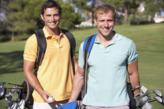 Two Men Enjoying Game Of Golf Stock Photography