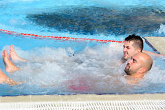 Two men enjoying jacuzzi hot tub bubble bath outdoor Stock Images