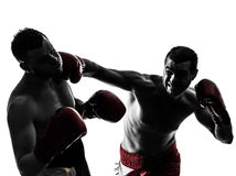 Two men exercising thai boxing silhouette royalty free stock photography