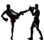 Two men exercising thai boxing silhouette Stock Images