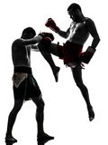 Two men exercising thai boxing silhouette Royalty Free Stock Photos