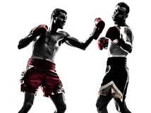 Two men exercising thai boxing silhouette. Two caucasian  men exercising thai boxing in silhouette studio  on white background Stock Image