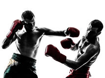 Two men exercising thai boxing silhouette stock photo