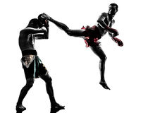 Two men exercising thai boxing silhouette Royalty Free Stock Images