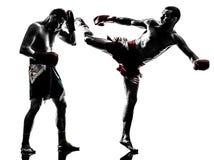 Two men exercising thai boxing silhouette Stock Photos