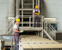 Two men on a factory Royalty Free Stock Image