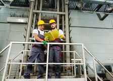 Two men on a factory Stock Image
