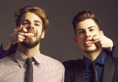 Two men with female fingers Royalty Free Stock Images