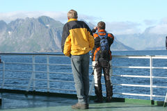 Two men on the ferry boat reaching the isle Royalty Free Stock Photography