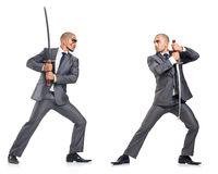 Two men figthing with the sword isolated on white Stock Image
