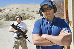 Two Men At Firing Range In Desert Royalty Free Stock Photography
