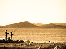 Two men fishing Royalty Free Stock Image