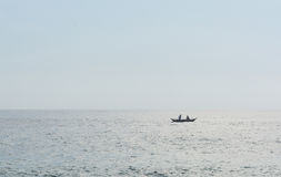 Two men in fishing boat Stock Image